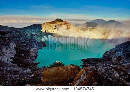 Beautiful Landscape And Green Lake With Smoke Sulfur In Kawah Ijen Volcano Indonesia