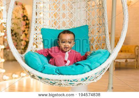 Happy Mixed Race Toddler Baby Boy indoors