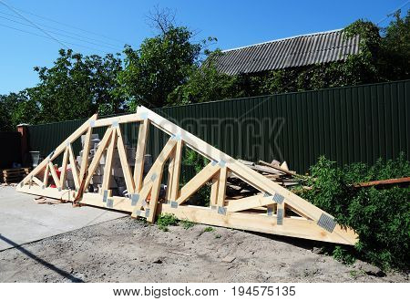 Roofing Construction. Install Roof Trusses and Wooden Beams.