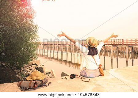 Happy asian woman breathing by the sea Vintage & Retro filter Summer and Travel concept