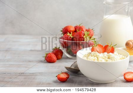 Fresh cottage cheese with fresh strawberries, healthy breakfast concept, selective focus, copy space