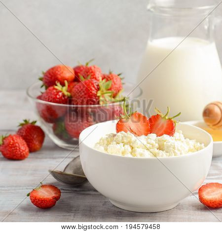 Fresh cottage cheese with fresh strawberries, healthy breakfast concept, selective focus, square format