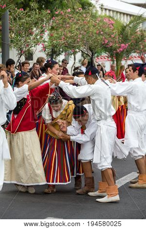 FUNCHAL PORTUGAL - SEPTEMBER 4 2016: Dancers with local costumes perform a folk dance during the parade of Wine Festival in Funchal on the Madeira Portugal.