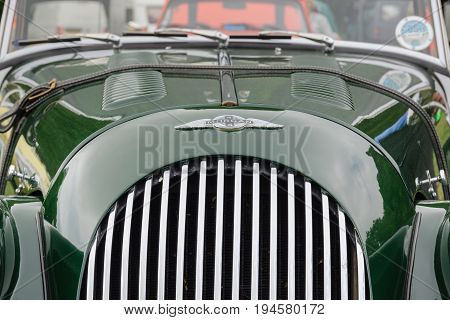 Llangollen Wales UK - July 1 2017: Bonnet badge on a Morgan 4/4 1600 two door roadster convertible a classic British car first built in 1936