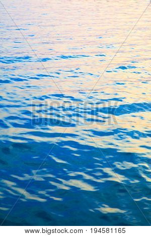Water surface of sea at sundown - colorful abstract background