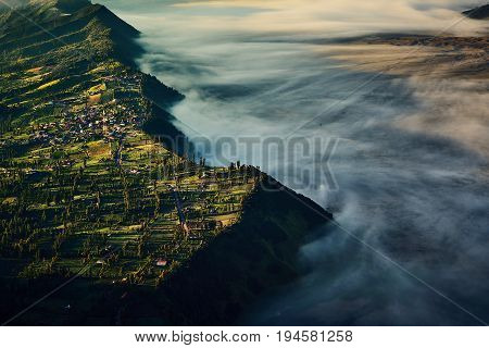 Powerful Nature From Cemoro Lawang Village View And Mist Landscape, Bromo Tengger Semeru National Pa