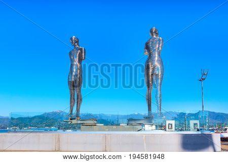 Batumi, Georgia - April 30, 2017: Moving metal sculpture Man and Woman or Ali and Nino in Batumi, Georgia