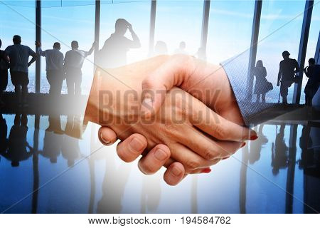 Business partners shaking hands after a meeting in a business office building