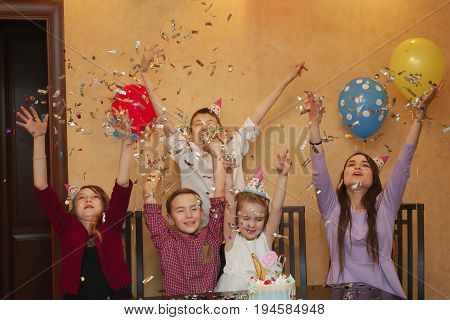 children throwing confetti at a children's party. kids have fun together on a family holiday