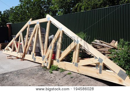 Wooden Roofing Construction. Install Roof Trusses and Wooden Beams.