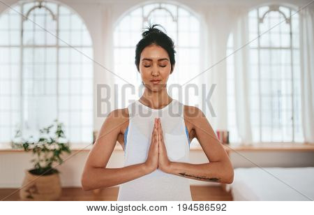 Healthy Woman Standing At Home With Her Hands Joined