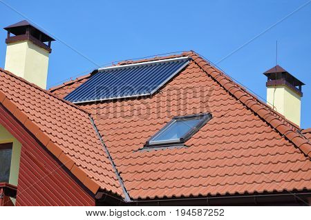 Ceramic roof tiles with roof window skylight solar panel vacuum solar water heating system chimney and Lightning Protection System. Lightning rod.