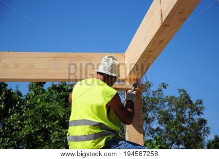 Roof Contractor. Roofing Construction. Install Roof Trusses and Wooden Beams. Roofer Install Wooden Truss.