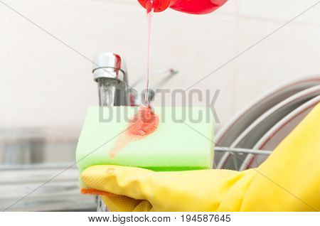 Closeup Of Cleaning Sponge And Bottle Of Detergent