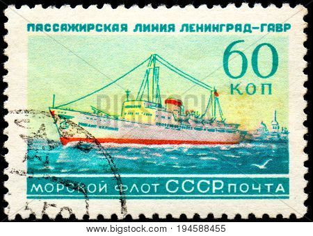 UKRAINE - CIRCA 2017: A postage stamp printed in USSR shows Soviet Liners Ship and Inscription Soviet Navy Passage line Leningrad - Havre from the series Ships circa 1959