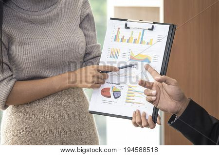 Asian woman presenting business plan to manager at office place woman working concept 20-30 years old.