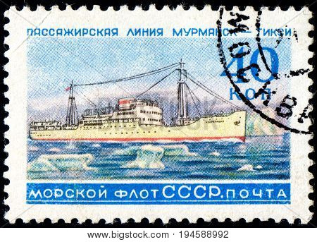 UKRAINE - CIRCA 2017: A postage stamp printed in USSR shows Soviet Liners Ship and Inscription Soviet Navy Passage line Murmansk - Tiksi from the series Ships circa 1959