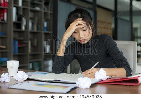 Asian woman working with serious situation at office woman with stressful concept 20-30 years old.