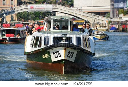 VENICE, ITALY - AUGUST 6: 'Vaporetti' Venice characteristic ferries the city public transport on water AUGUST 6, 2015 in Venice, Italy