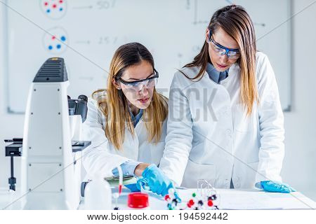 Biotechnology In The Lab, Tone Dimahe, Two People