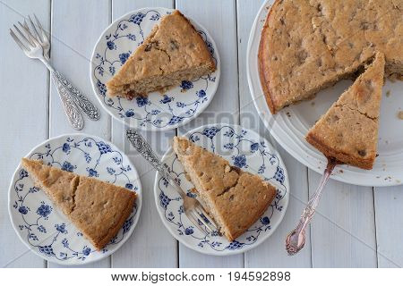 Flat Lay Spiced Apple Cake from Above Served on Plates on White Wooden Background