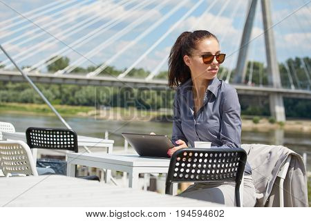 woman working with laptop/internet/online shopping at outdoor park, smile/fresh and happy relaxing