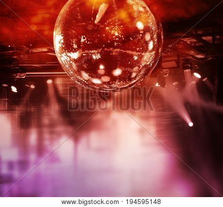 Colorful disco mirror ball lights night club background