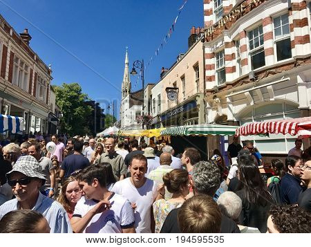 HAMPSTEAD - JULY 2, 2017: Over 100 stalls line a bustling Heath Street to a backdrop of live music, street entertainment and family attractions in Hampstead, North London, UK.