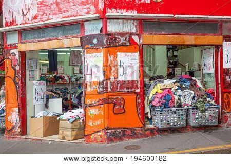 PARIS FRANCE - JUNE 6, 2012: A shabby second-hand clothing shop in Montmarte in Paris.