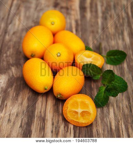 Kumquats On A Wooden Table
