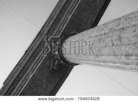 Column. Monochrome. Monochrome image of a fragment of a column. Sky. Column.