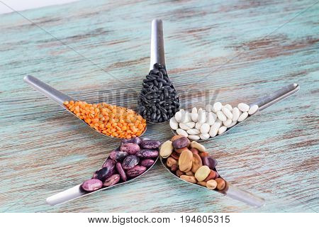Orange Lentils, Black, White, Brown, Purple Kidney Beans On Spoons