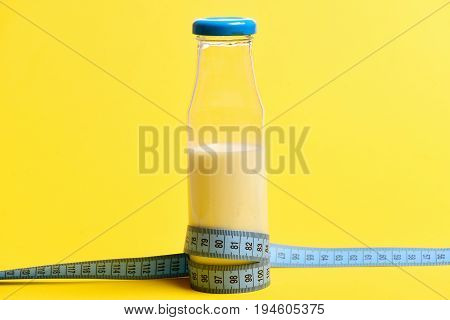 Concept Of Protein Nourishment With Bottle Of Milk And Ruler