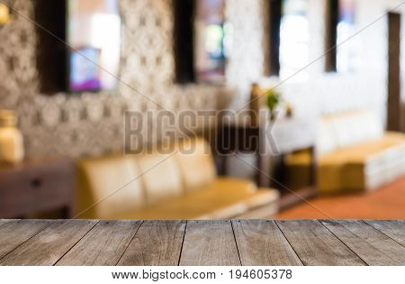 Empty Wooden Table In Front Of Hotel Corridor Blurred Background With Selective Focus
