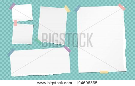 White note, notebook, copybook paper strips stuck with colorful sticky tape on turquoise squared background