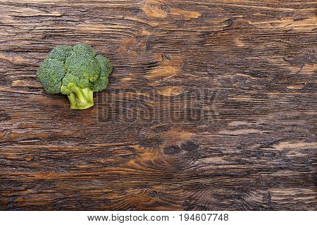 Fresh broccoli on wooden table close up. With space for text
