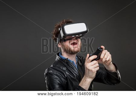 Man with a game controller wearing virtual reality goggles