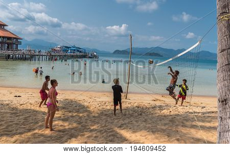 Thailand Koh Chang  - 18 March 2015. Tourists playing beach volleyball on the coast of the Koh Rang Isle of Ko Rang National Park, Koh Chang, Thailand