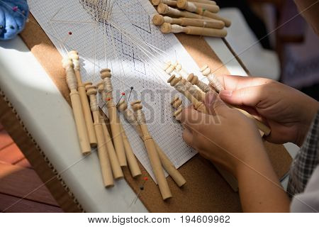 Skilled female hands at the traditional lace making crafts,bobbin lace making