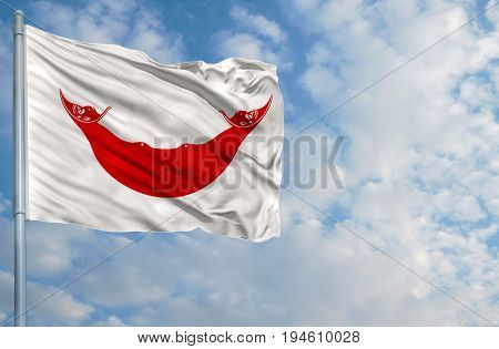 National flag of Easter Island Rapa Nui on a flagpole in front of blue sky.