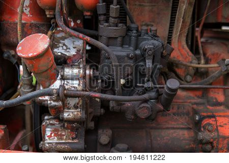 detail of old and dirt engine full of black greases