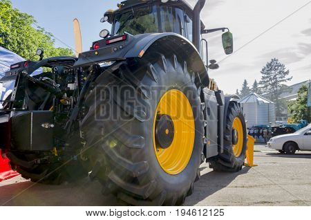 Yellow large tractor machine for sowing preparation and cultivation of soil for farmers