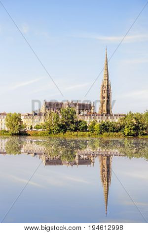 Riverside view on Garonne river with saint Michel cathedral in Bordeaux city, France