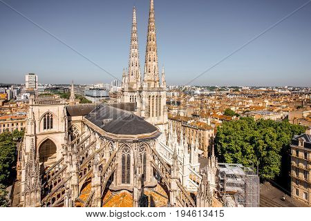 Aerial cityscape view on the old town of Bordeaux city with saint Pierre cathedral during the sunny day in France