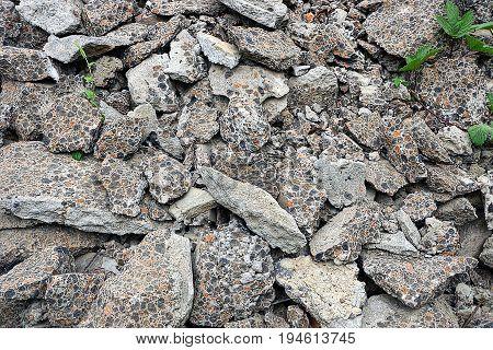 Building debris from broken gray pieces of asphalt