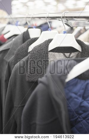 Men's jackets on the counter in the store