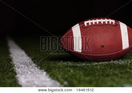 Football resting on the first down line