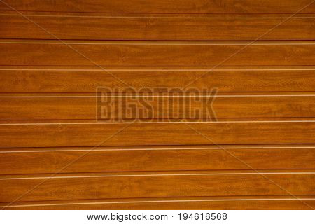 Brown background of wooden fence boards on the street