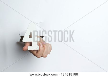 Female Hand Holding A Four Digit White Background.