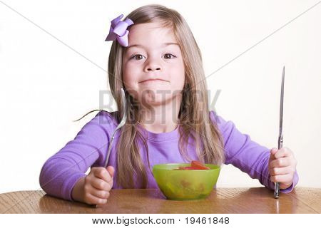 Cute little girl ready to Eat a Healthy Meal